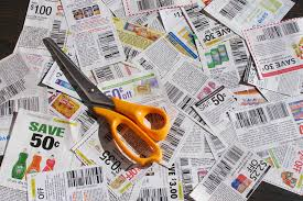 save money clipping coupons