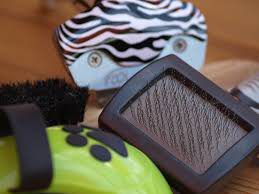 A slicker brush and a shedding brush
