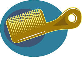 A yellow cartoon comb with a blue bacground